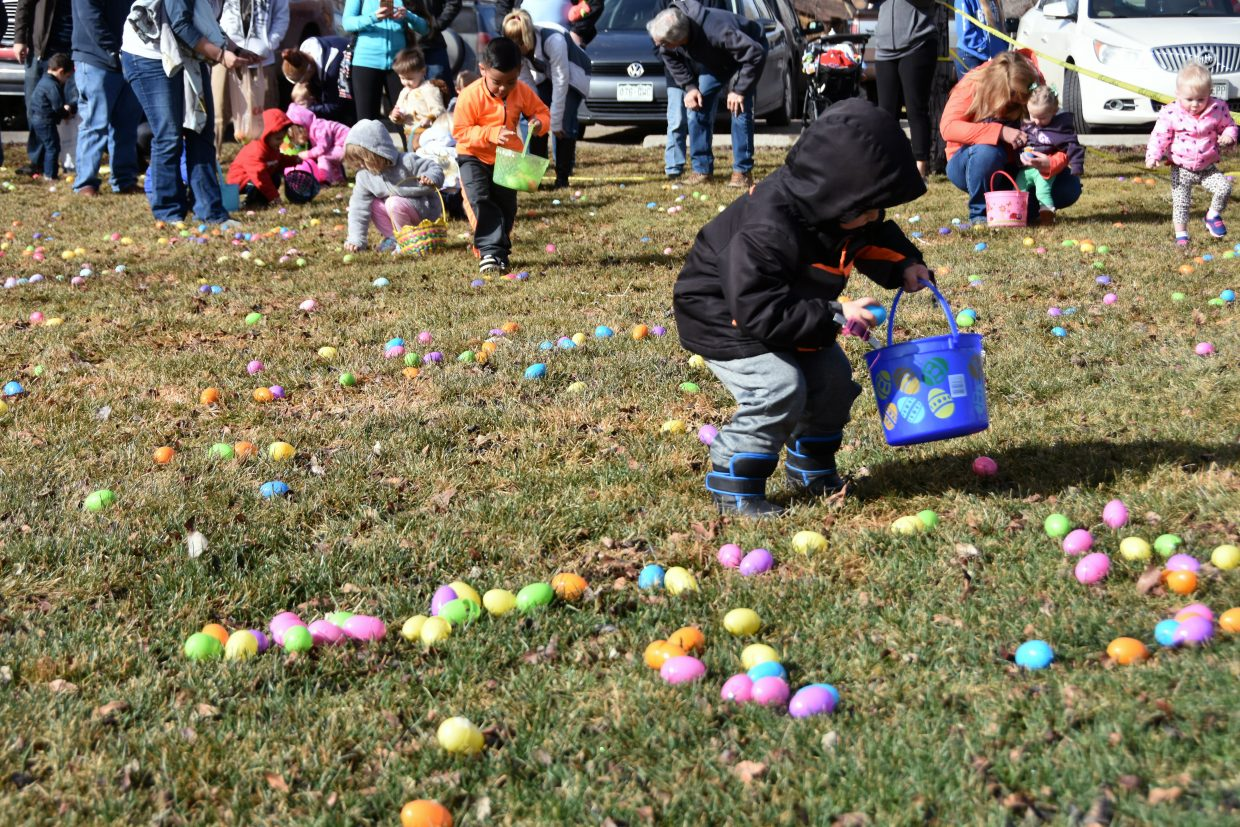 Children collect Easter eggs at the State Farm Easter Egg Hunt. At least 100 kids participated in the egg hunt.