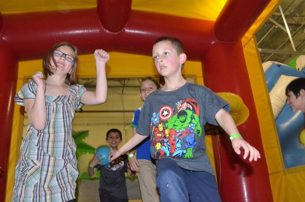 Kids bounce around during Saturday's Easter egg hunt at Adventure Zone.