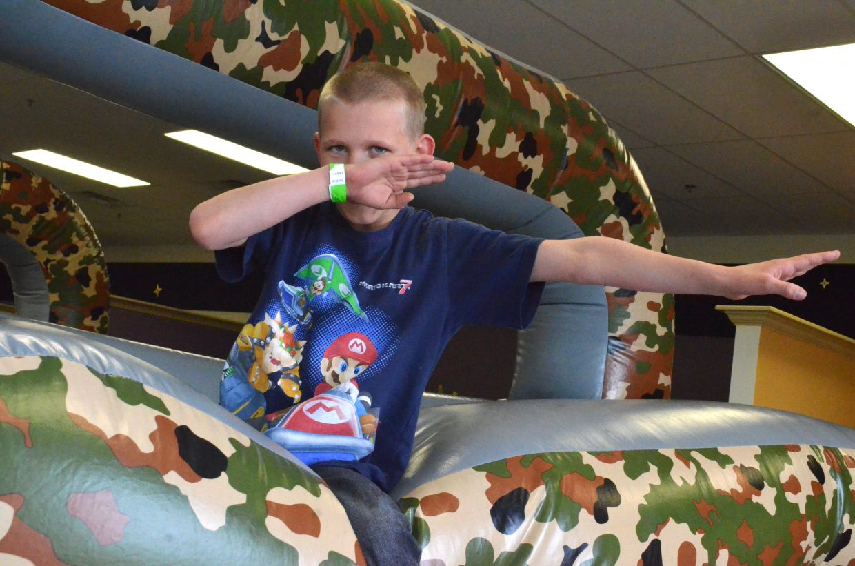 Wyat Hancock, 8, does the dab while climbing atop the equipment at Adventure Zone following Saturday's Easter egg hunt.