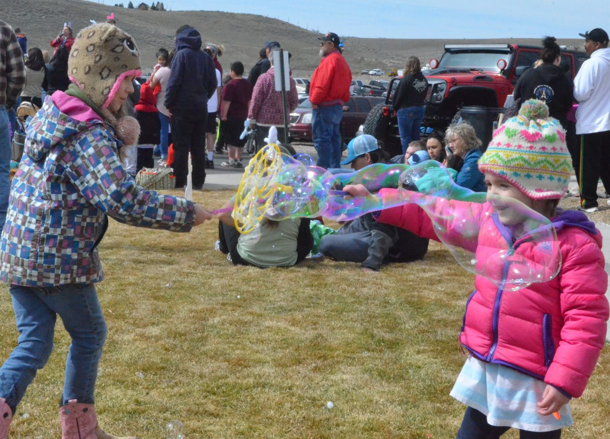 Sisters Lexi, left, 8, and Mia Stabile, 4, create some fun with bubbles during New Creation Church's Easter egg hunt.