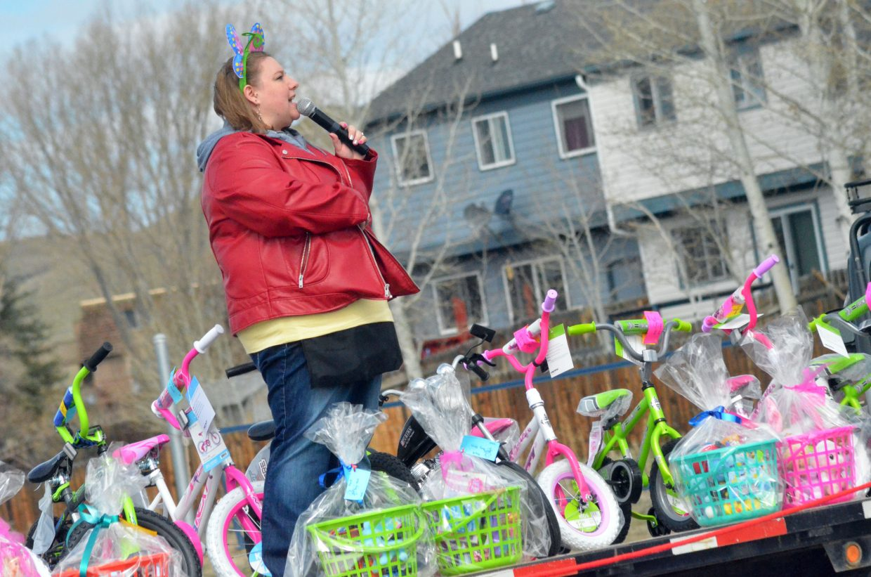 Event organizer Amber Goodenow makes announcements leading up to New Creation Church's Easter egg hunt.