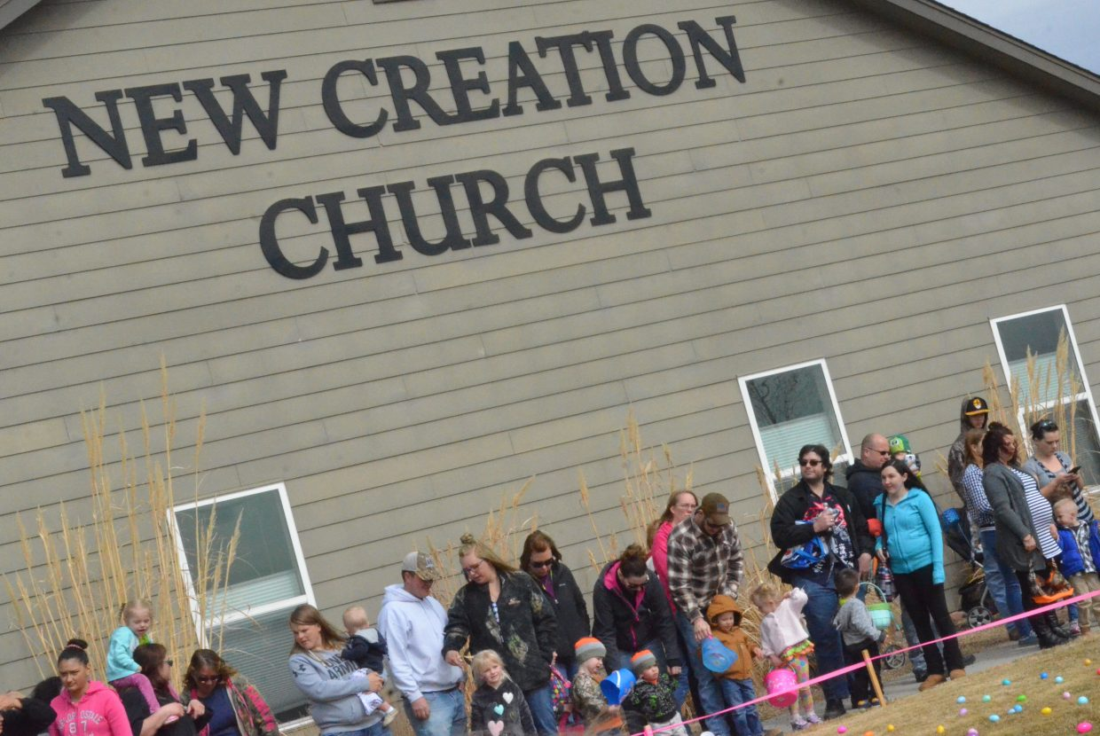 The crowd readies for the start of New Creation Church's Easter egg hunt.