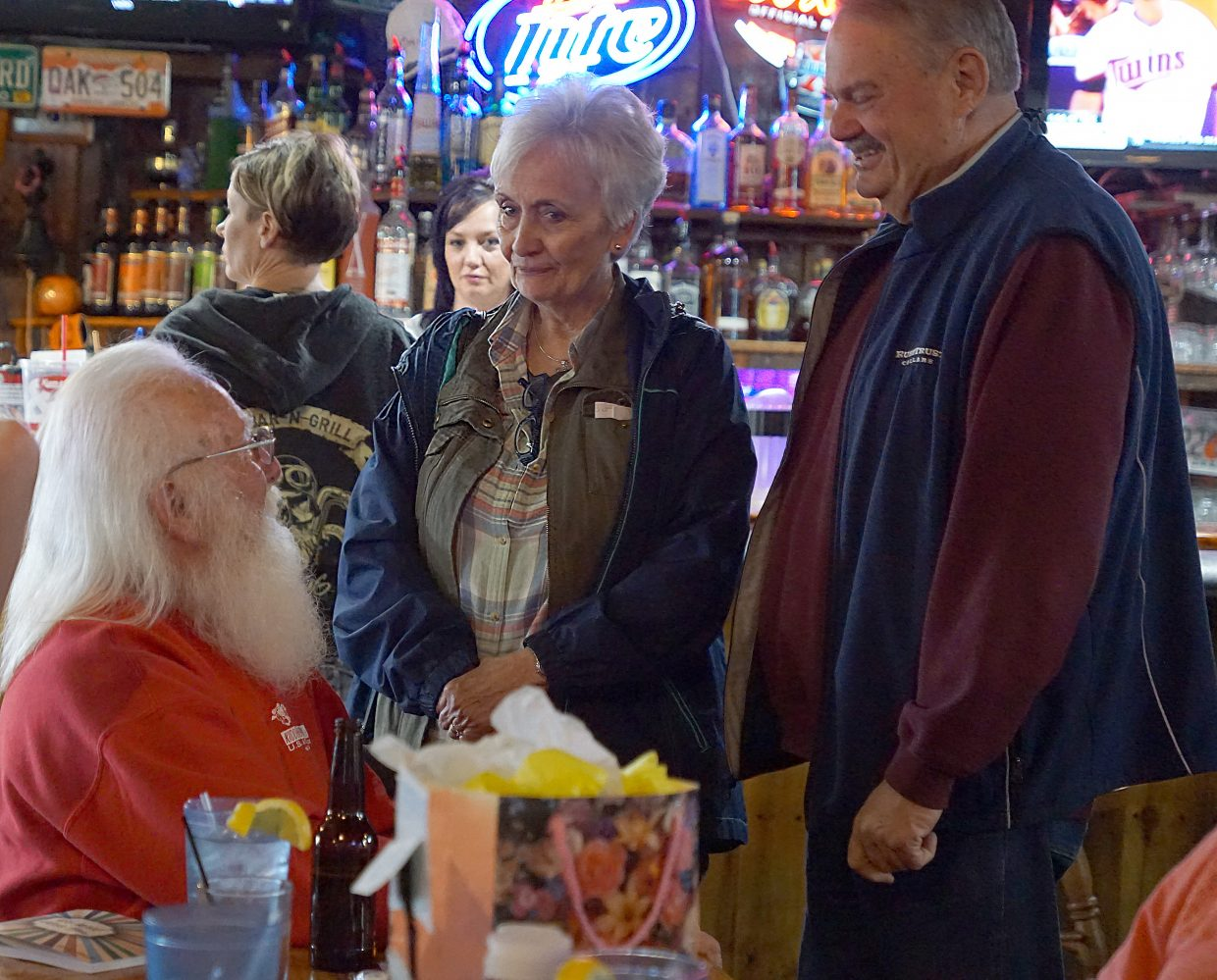 George Kidder, better known to many as Craig's Santa Claus, talks with family and friends during a send off party at OP Bar and Grill.