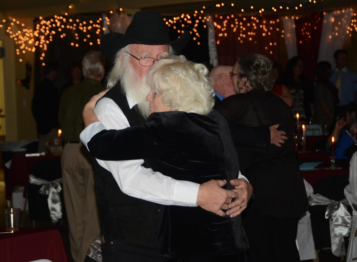 George and Ann Kidder dance together at the annual Craig Rotary Club's Diamonds & Spurs.