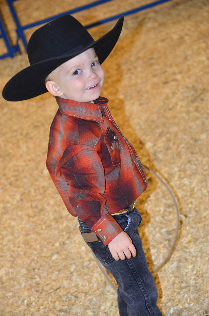 Austin Jazwick, then 3, smiles at the audience of the 2014 Cowboy Baby Contest at the Moffat County Fair.