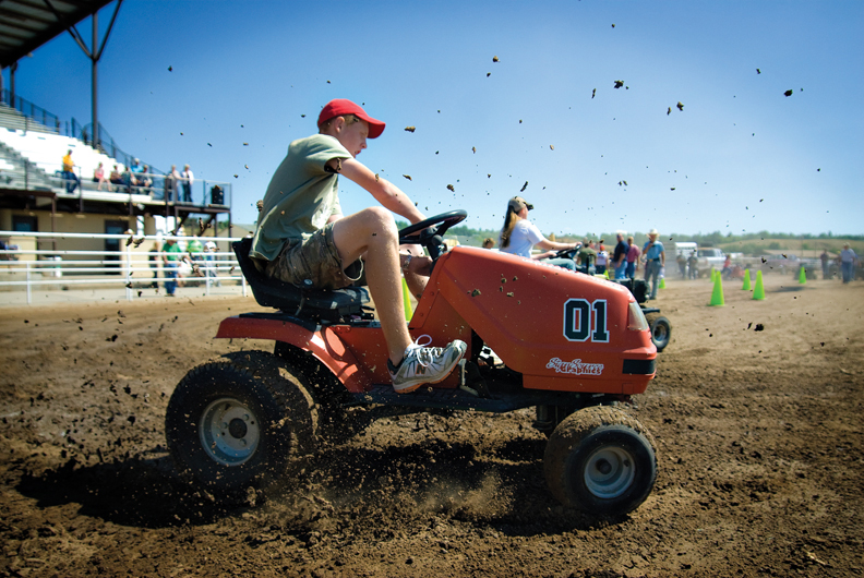 Wyatt Oberwitte makes a turn during lawnmower races at the 91st annual Moffat County Fair. This year, the fair celebrates its 100th year.