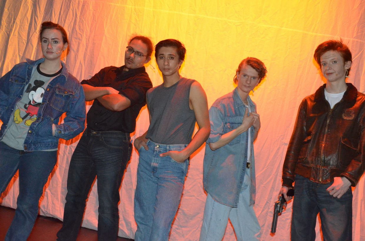 From left, Two-Bit (Courtney Smith), Darry (Daniel Moore), Ponyboy (Sambu Shrestha), Johnny (Jeremy Looper) and Dally (Aaron Hill) pose against the sunset in