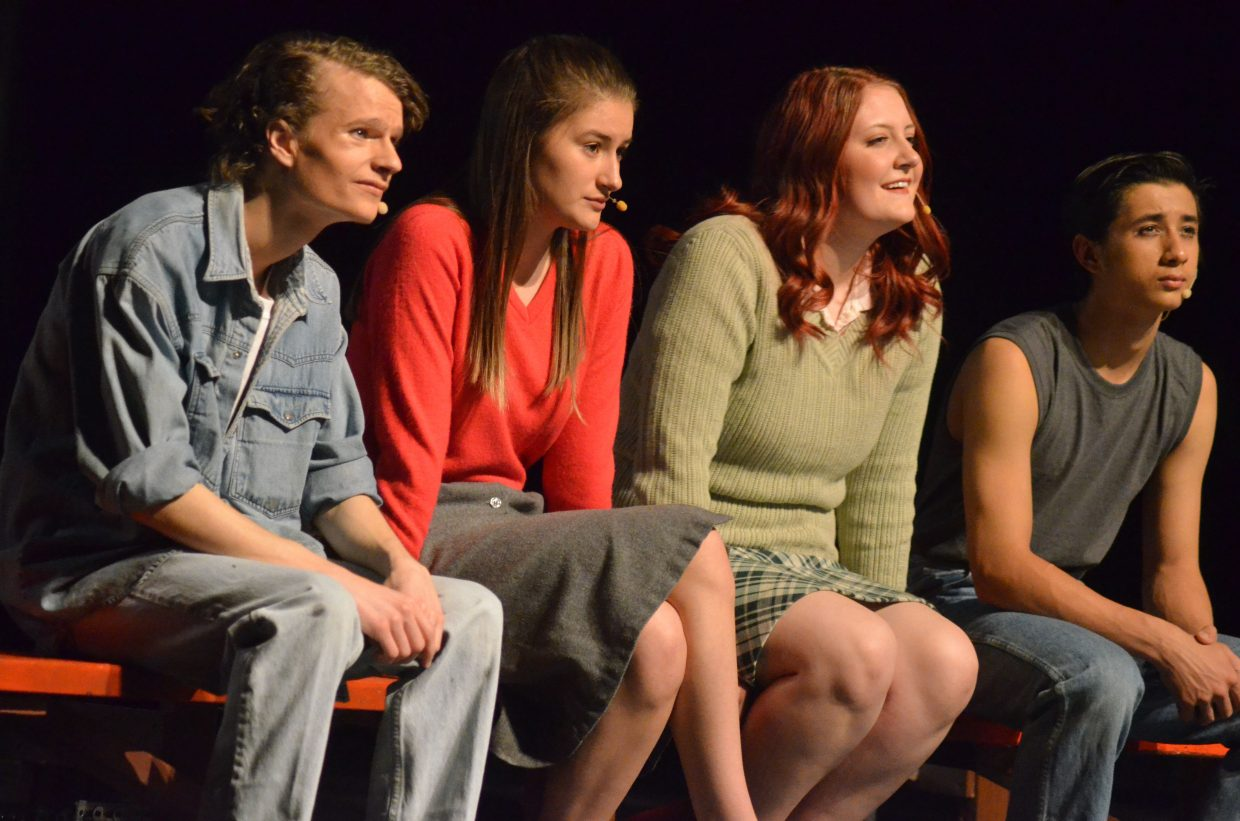 From left, Johnny (Jeremy Looper), Marcia (Tess Willems), Cherry (Olivia Neece) and Ponyboy (Sambu Shrestha) take in a drive-in movie in