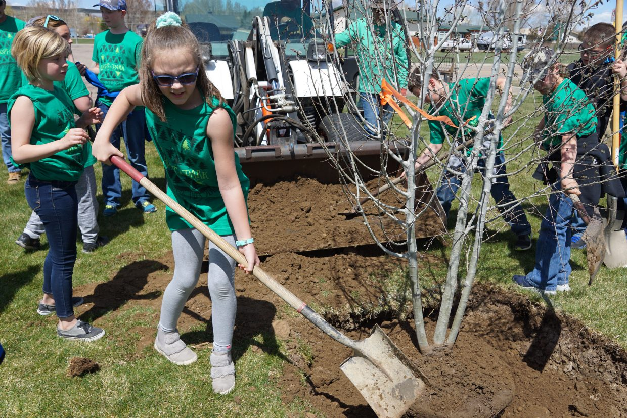 Helping to plant a tree in recognition of Arbor Day was the first act for elementary school students participating in a new