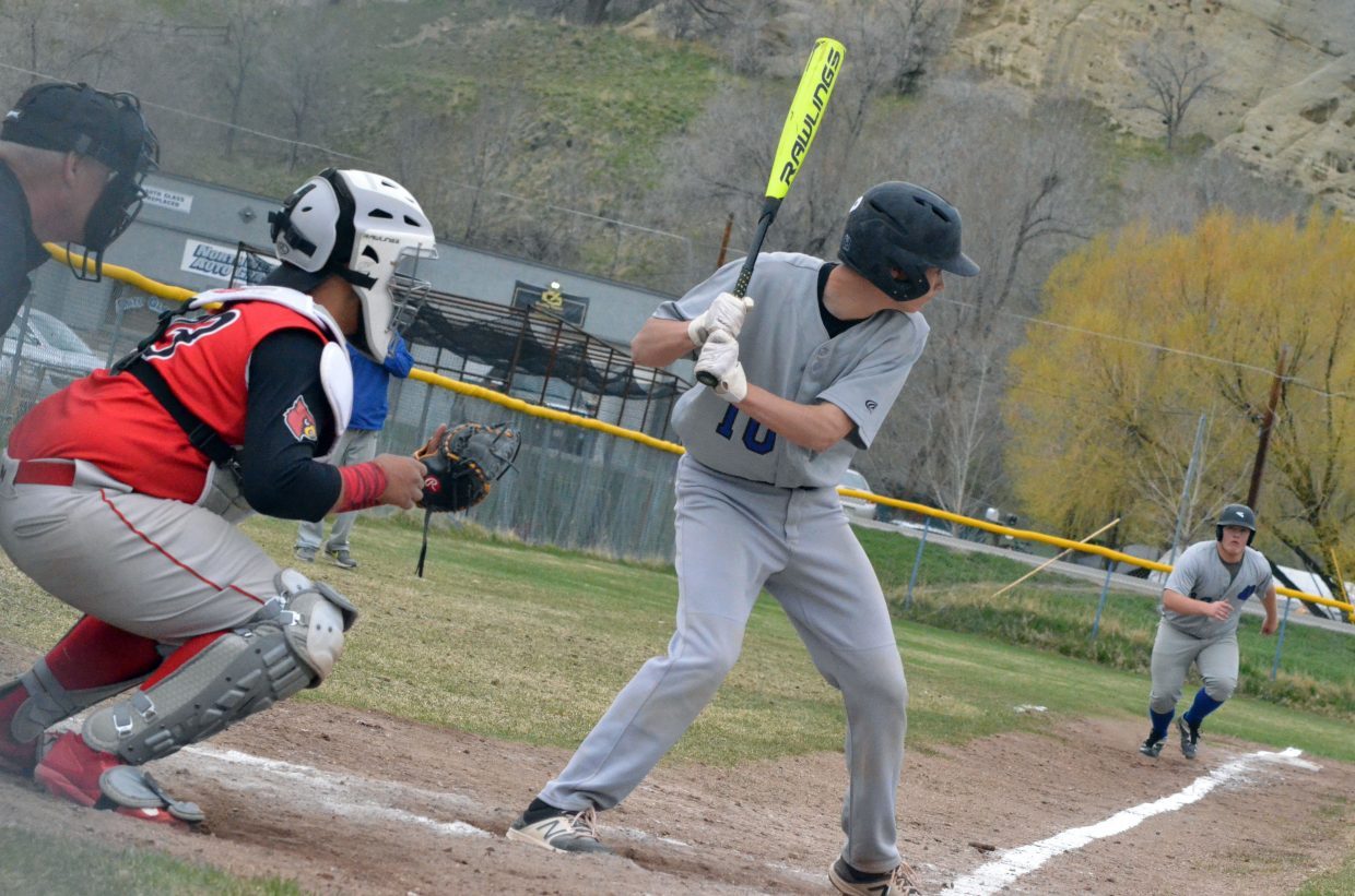 Moffat County High School's Krece Papierski is at bat as Drake Doherty takes a lead off third base.
