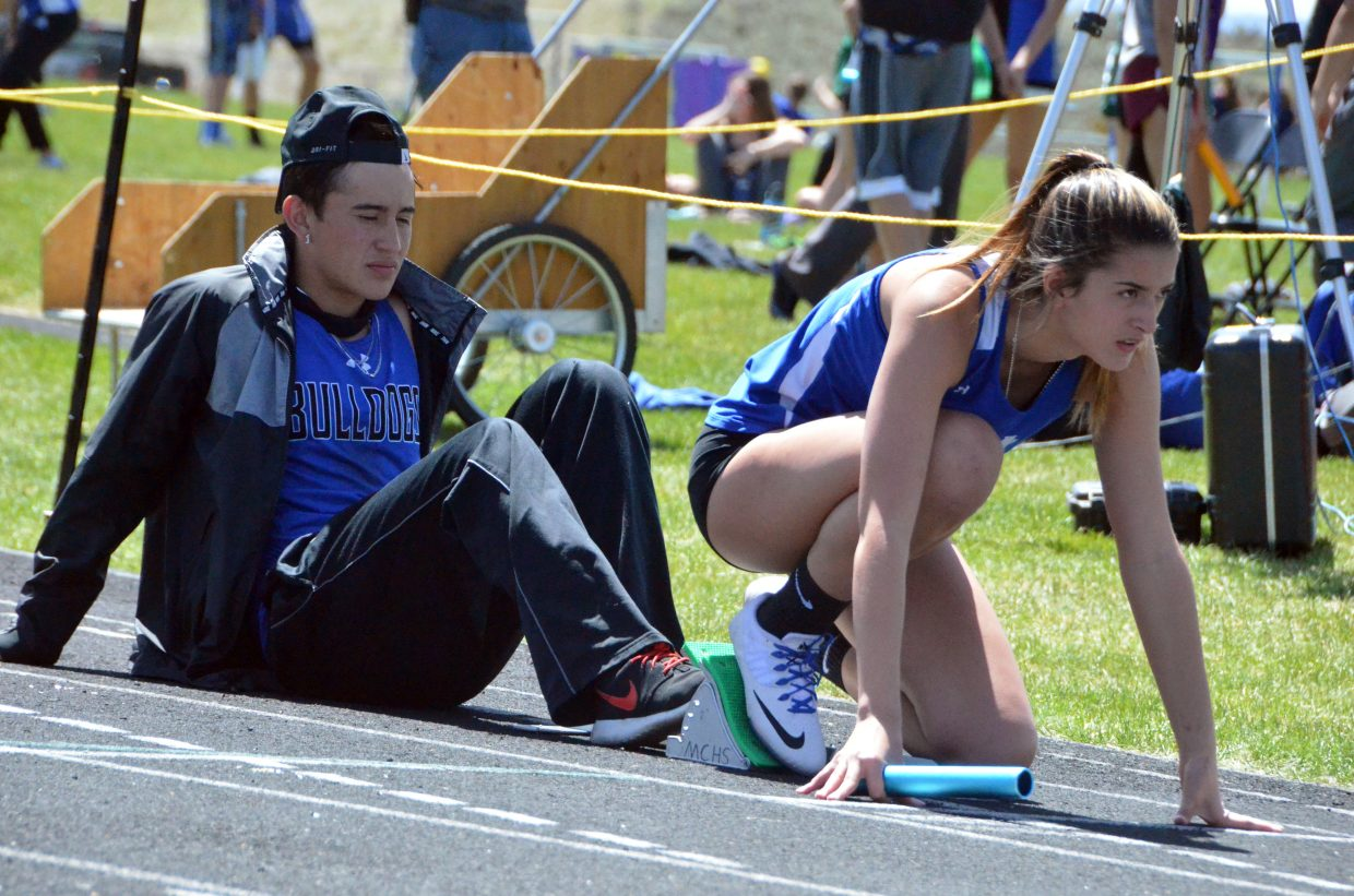 Moffat County High School's Hannah Vasquez gets in position to start the girls 4x100-meter relay Friday at the Clint Wells Invitational.