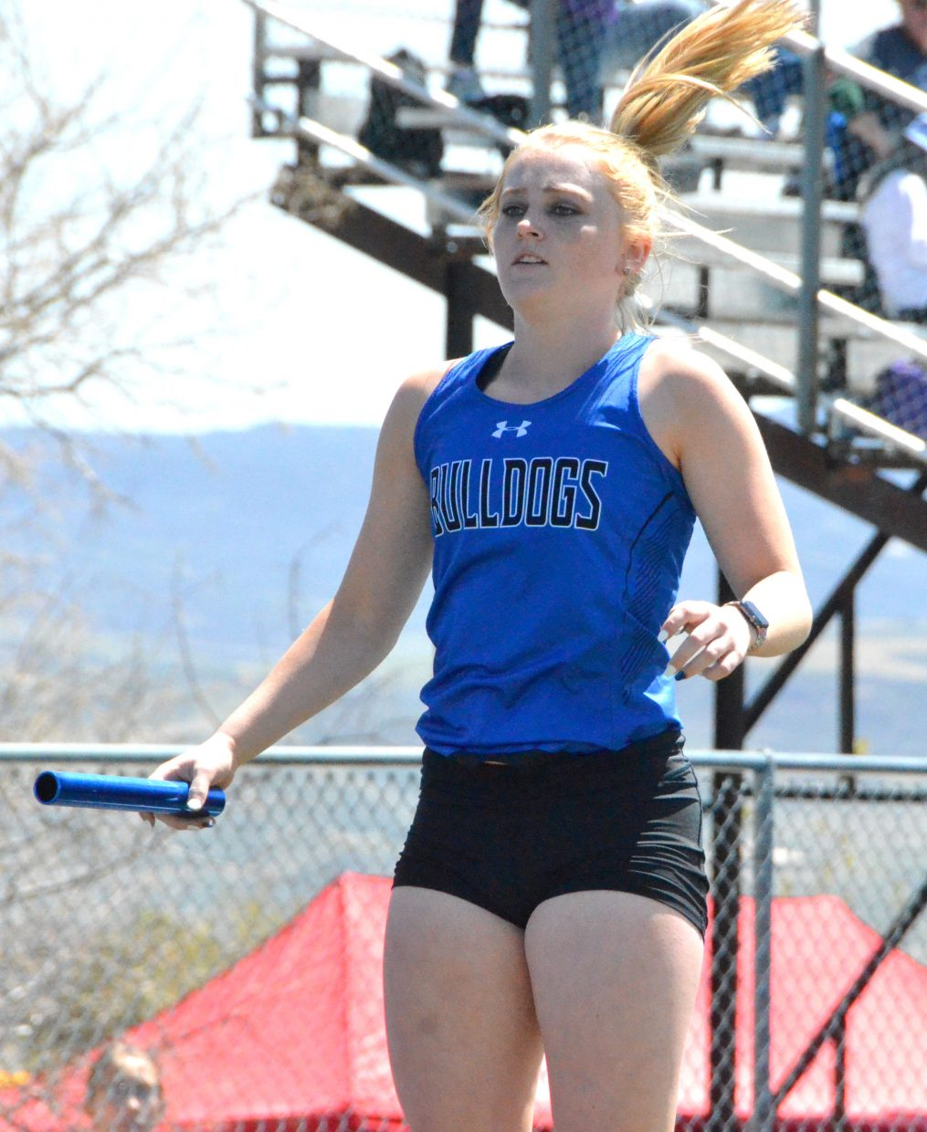 Moffat County High School's Jaidyn Steele gets pumped up for the girls 4x200-meter relay Friday at the Clint Wells Invitational.