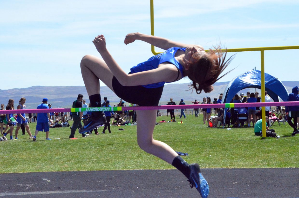 Moffat County High School's Eliana Mack gets some height in the girls high jump Friday at the Clint Wells Invitational.