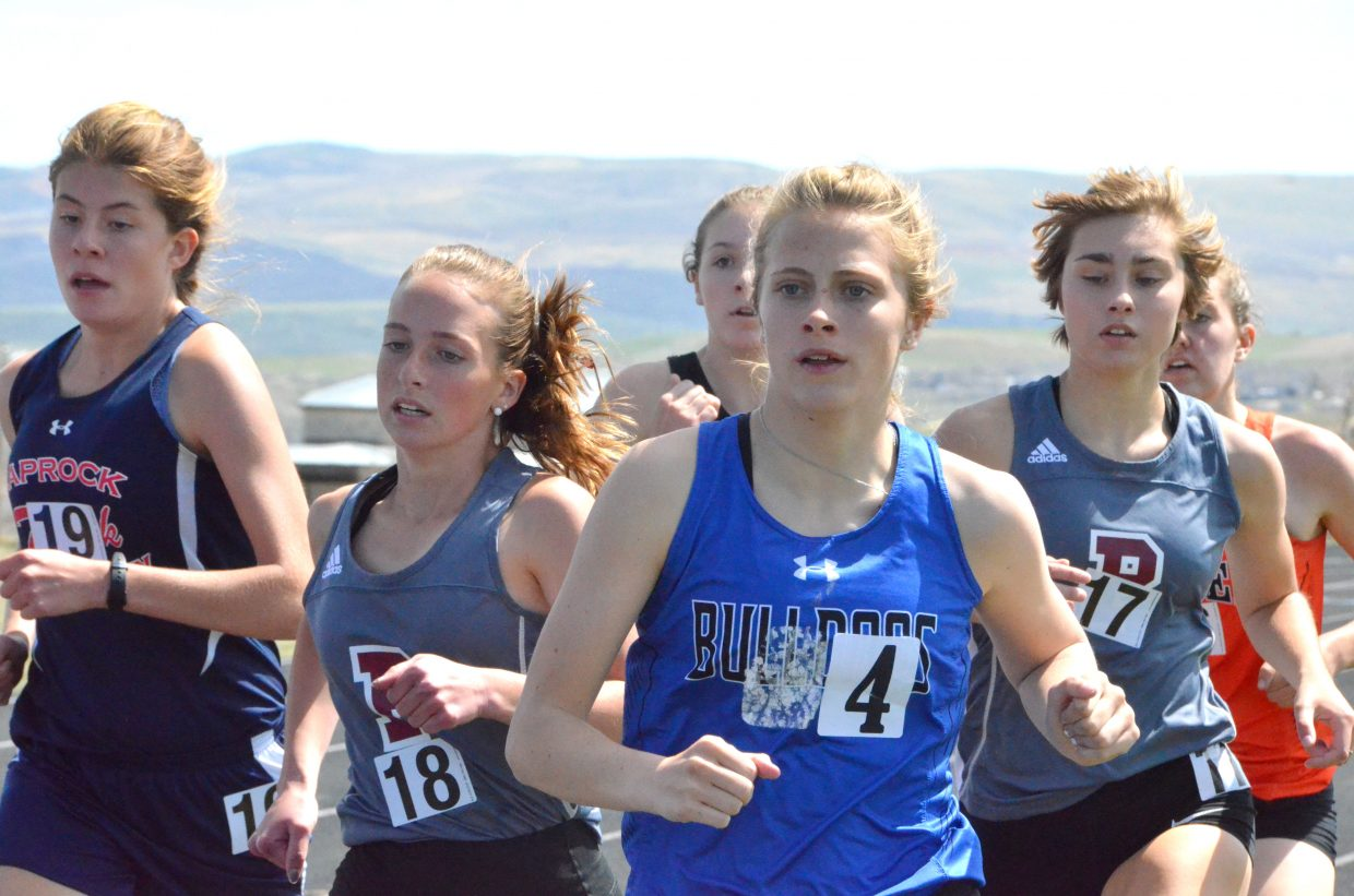 Moffat County High School's Kelsey McDiffett looks to break away from the pack in the 800-meter run Friday at the Clint Wells Invitational.