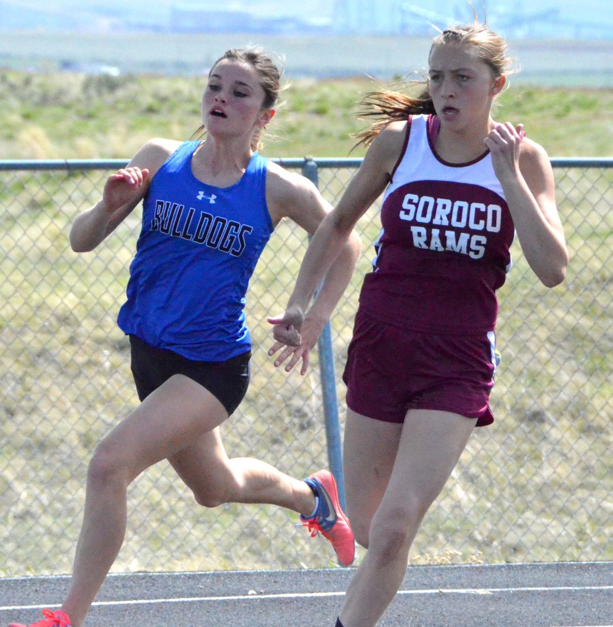 Moffat County High School's Stephenie Swindler moves into the turn during the girls 200-meter dash Friday at the Clint Wells Invitational.