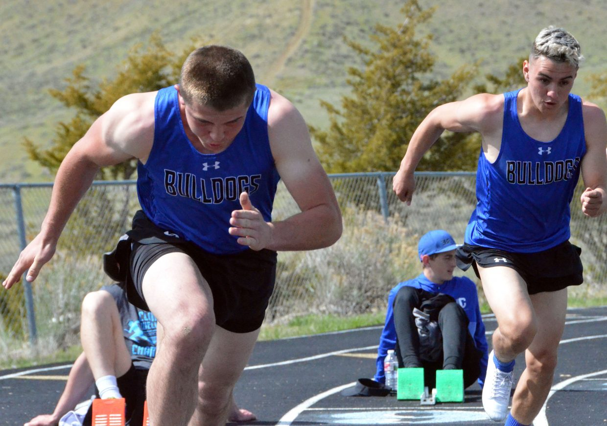 Moffat County High School's Elias Peroulis, left, and Victor Silva, explode from the starting blocks in the boys 200-meter dash Friday at the Clint Wells Invitational.