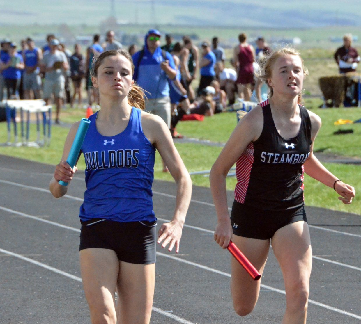 Moffat County High School's Stephenie Swindler works to keep the lead in the first leg of the girls 4x400-meter relay Friday at the Clint Wells Invitational.
