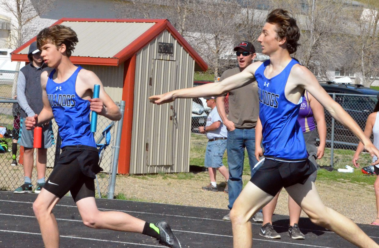 Moffat County High School's Wilson Eike, left, accepts the baton from AJ Barber in the 4x400-meter relay Friday at the Clint Wells Invitational.