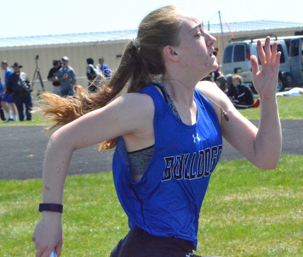 Moffat County High School's Raine Harrell gets moving in the girls 4x200-meter relay Friday at the Clint Wells Invitational.