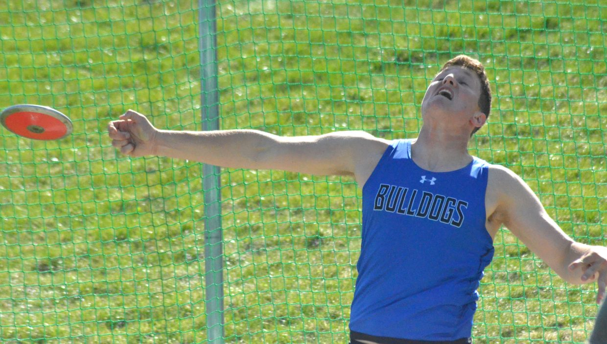 Moffat County High School's Toryn Hume releases his final throw in the discus Friday at the Clint Wells Invitational.
