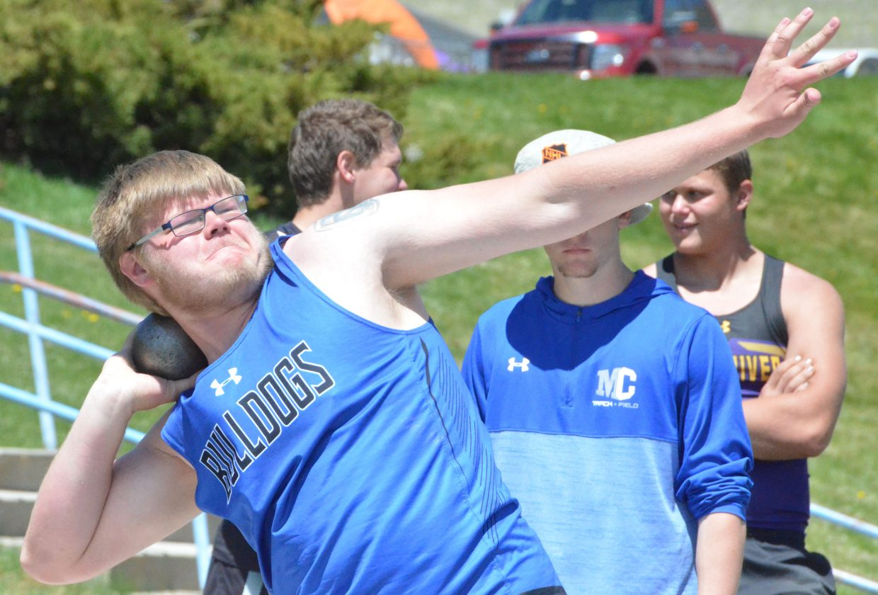 Moffat County High School's Zane Shipman goes into motion in the shot put Friday at the Clint Wells Invitational.