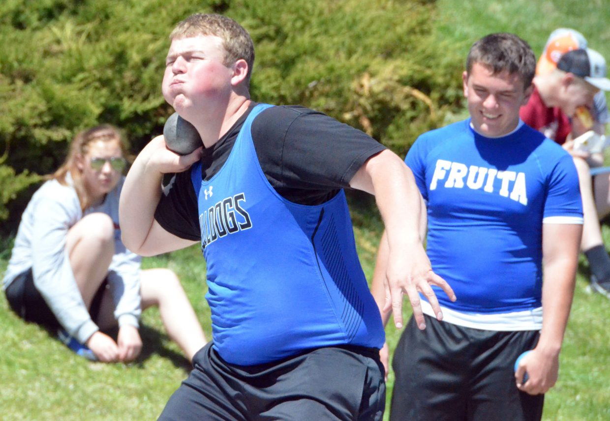 Moffat County High School's Jesse Earle practices his technique before the finals in the shot put Friday at the Clint Wells Invitational.