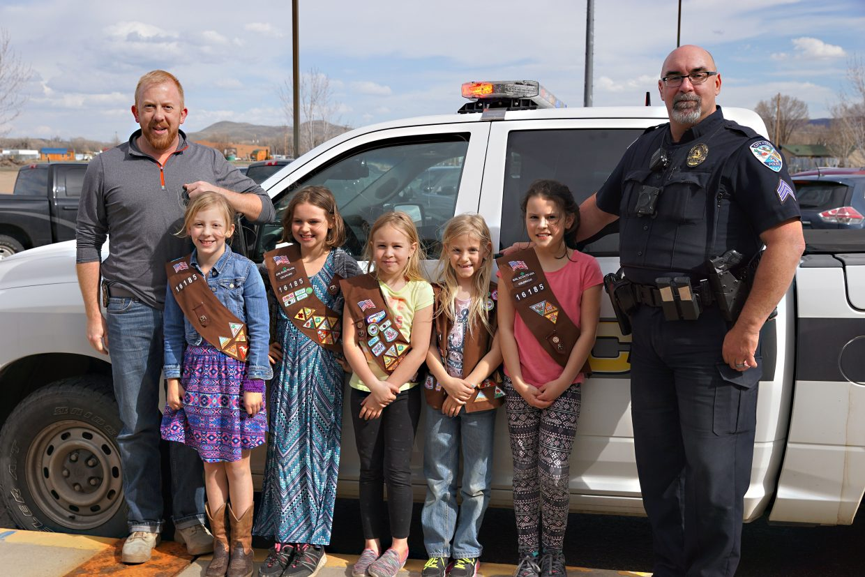After Girl Scouts treated officers to cookies, officers returned the favor by offering the girls a tour of a truck used by the Craig Police Department.  Pictured, from left, are Officer Grant Laehr, Audrey Laehr, Xya McMahon, Madison Doolin, Josie Terry, Haley Duran and Sergeant Anthony Fandel.
