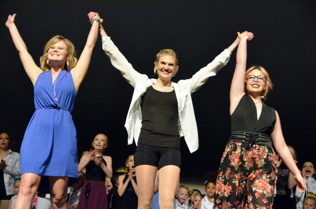 From left, Just Dance instructors Shaeli Hatten, Jeni Giedd and Jamie Ferree take one final bow following Saturday's spring recital.