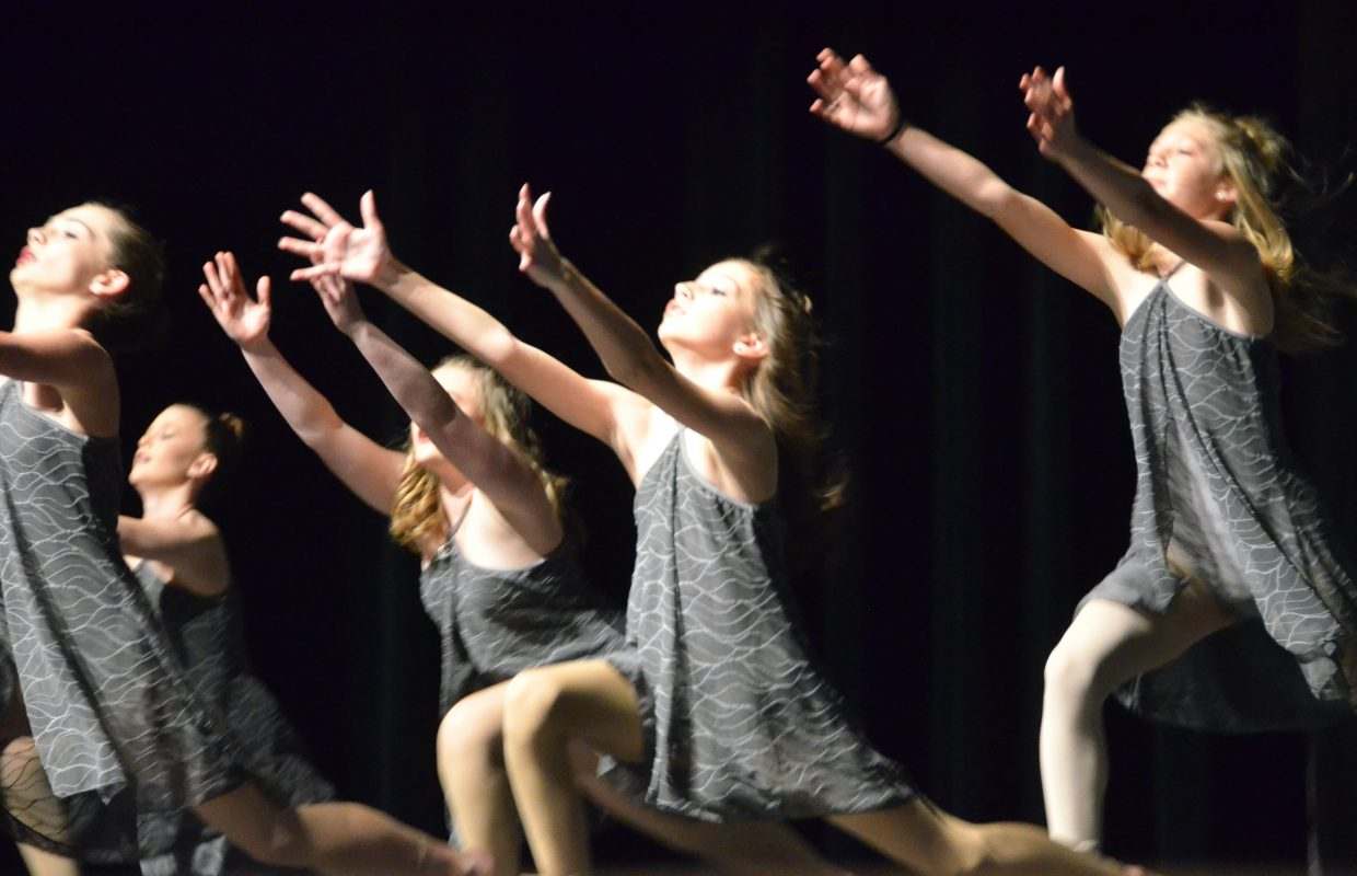 The competition team finishes with flair during Saturday's Just Dance spring recital.