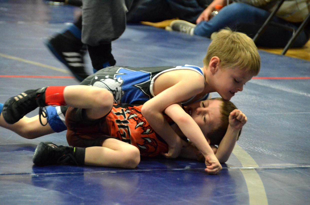 Kale Higgins rolls Hayden's Ryan Heaney into pin position in Saturday's Levi Weber Memorial Tournament.