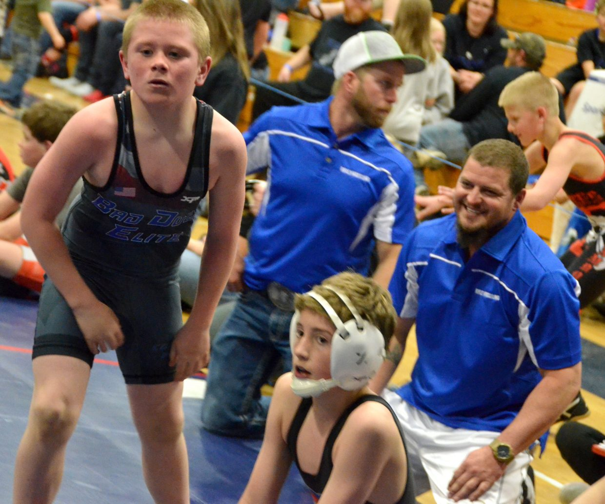 Zach Hedman confers with coaches as he gets a breather in Saturday's Levi Weber Memorial Tournament.