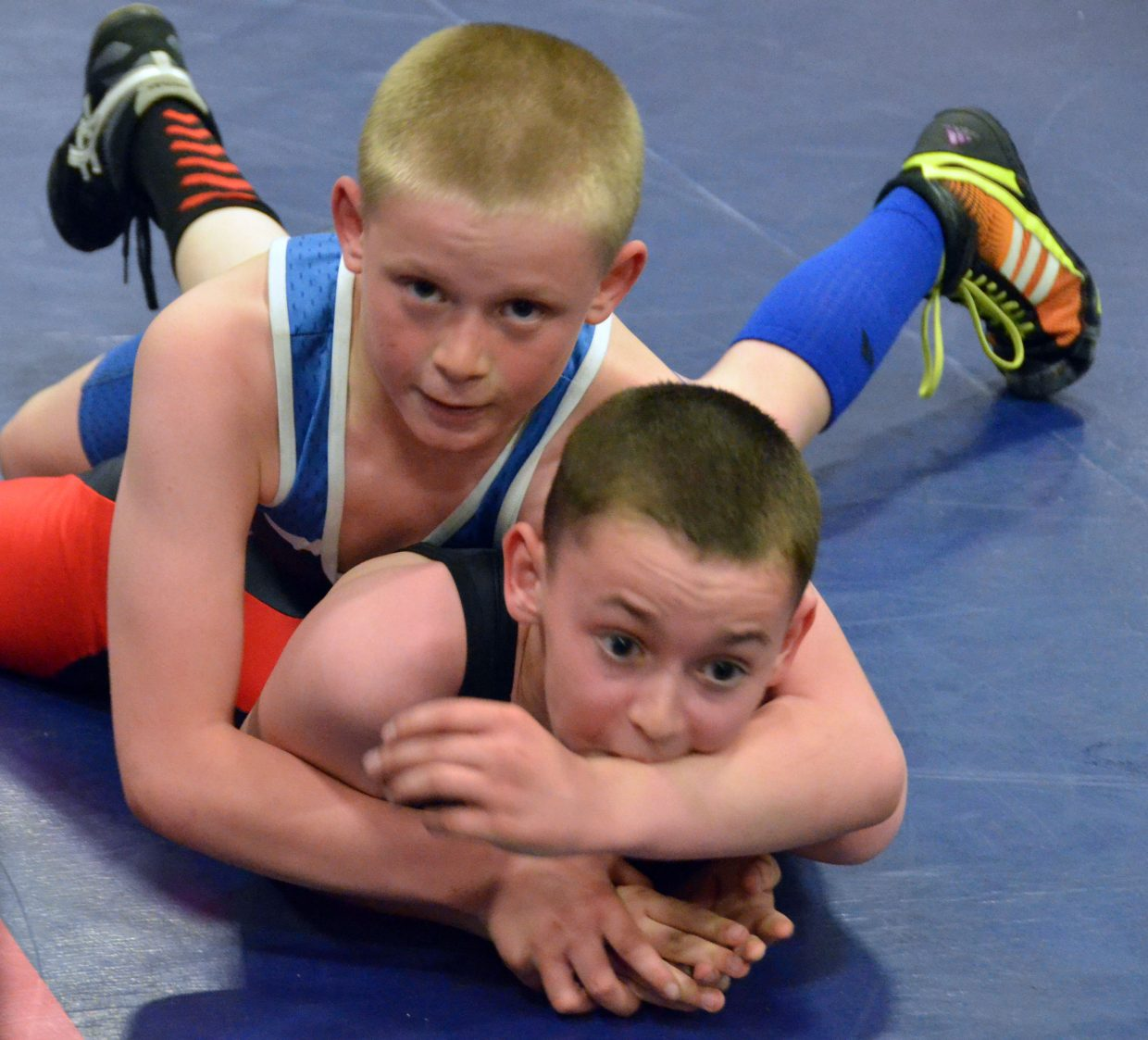 Kaleb Duzik has things under control with Grand Valley's Ean Olmstead in Saturday's Levi Weber Memorial Tournament.