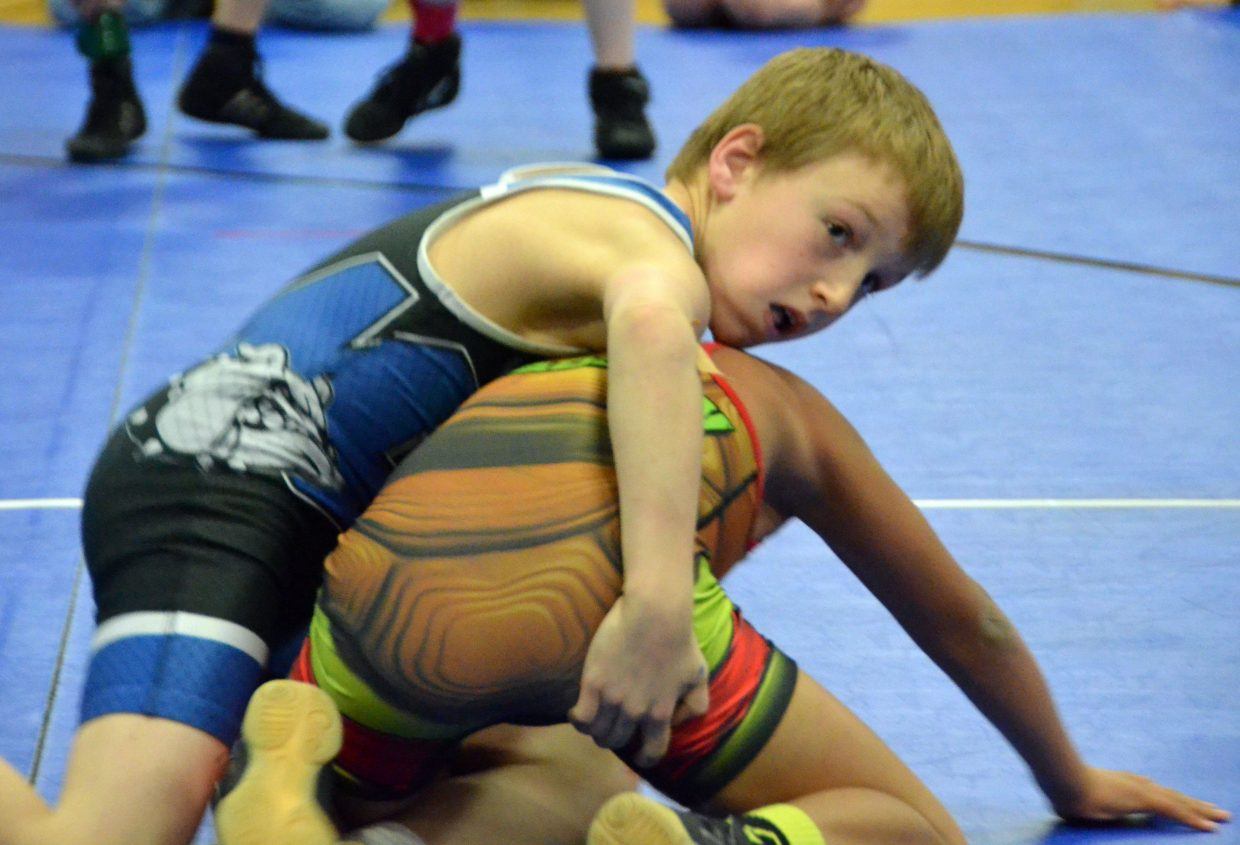 Paxton Hartung looks to his coaches for advice in Saturday's Levi Weber Memorial Tournament.