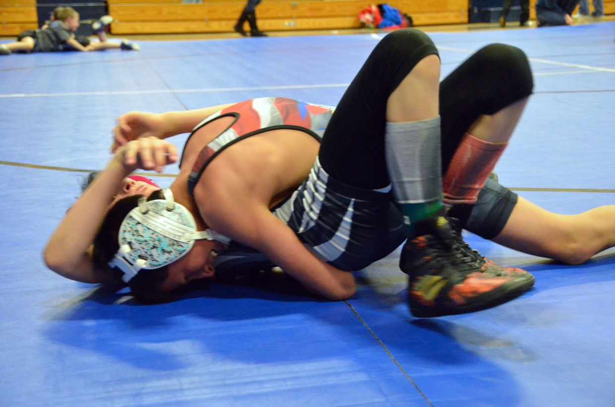 Adriel Vigil pushes for a pin in Saturday's Levi Weber Memorial Tournament.