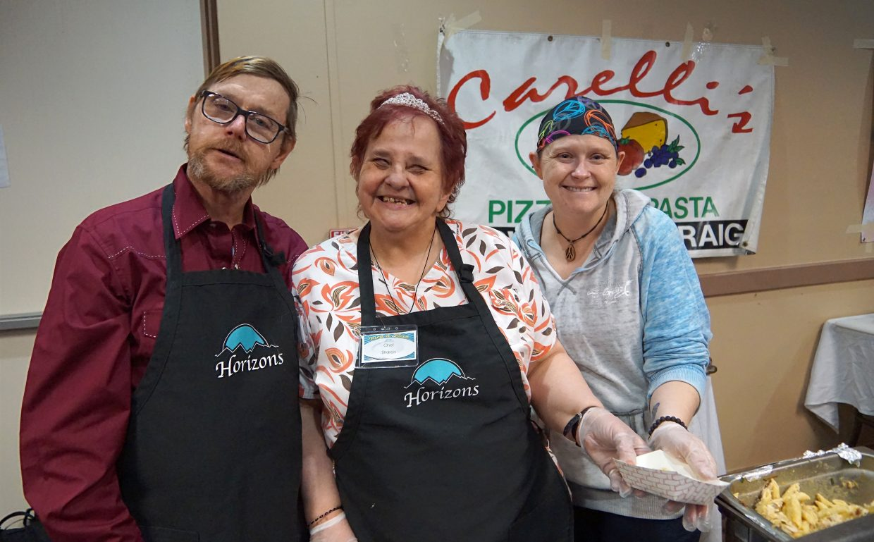 The Carelli's Pizza team offers big smiles along with bowls of pasta.