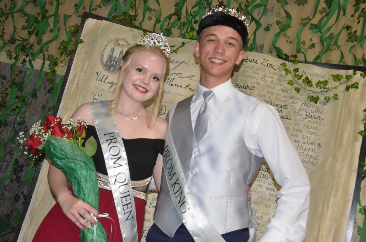 Guro Lian, left, and Jacob Briggs pose onstage after receiving Prom Queen and King during Moffat County High School prom at Clarion Inn & Suites.