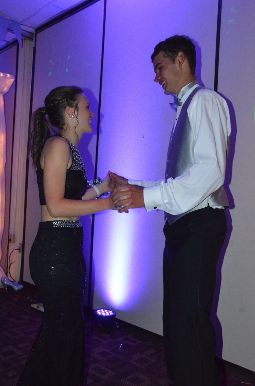 Taylor Kirby, left, and Carlin King share a dance during Moffat County High School prom at Clarion Inn & Suites.