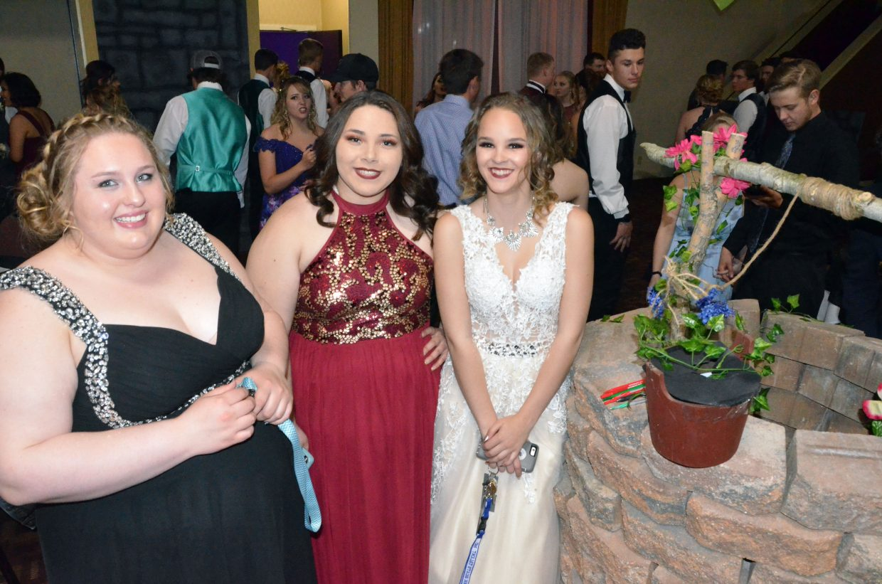 From left, Sammi Beaver, Tessona Gonzalez and Trinity Schenck enjoy the décor during Moffat County High School prom at Clarion Inn & Suites.