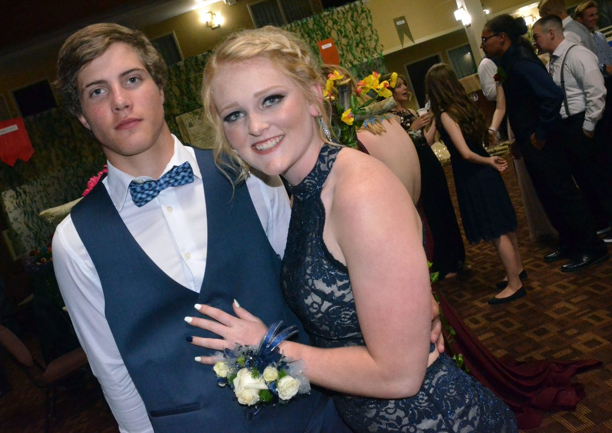 Cale Scranton, left, and Jaidyn Steele pose during Moffat County High School prom at Clarion Inn & Suites.