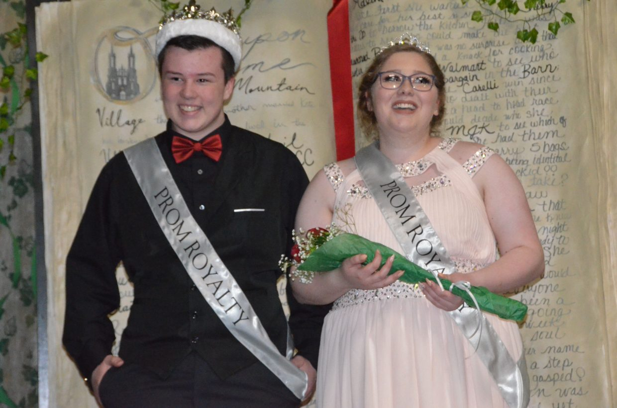 Hunter Petree, left, and Kamryn Jones pose onstage after receiving Prom Prince and Princess during Moffat County High School prom at Clarion Inn & Suites.