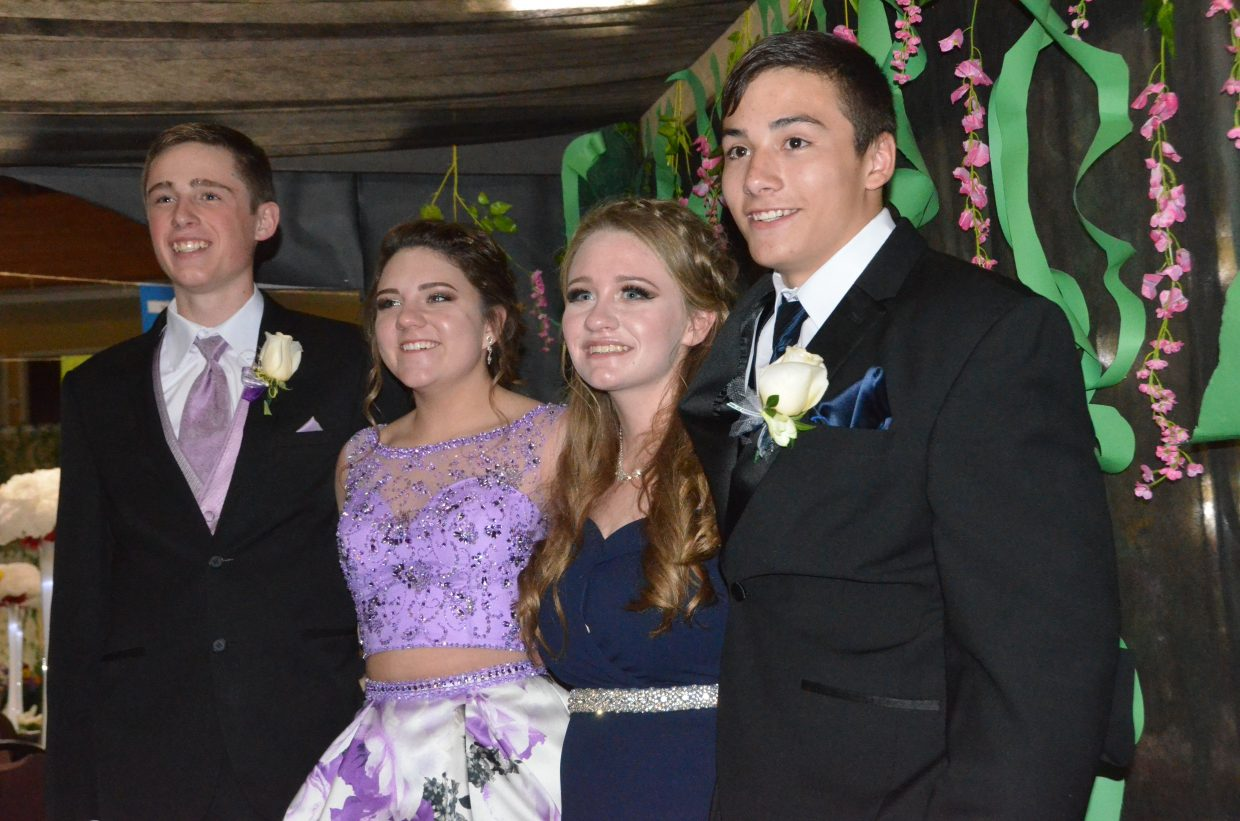From left, Brandon Beason, Katelynn Turner, Molly Neton and Ethan Powers enter the Moffat County High School prom at Clarion Inn & Suites.