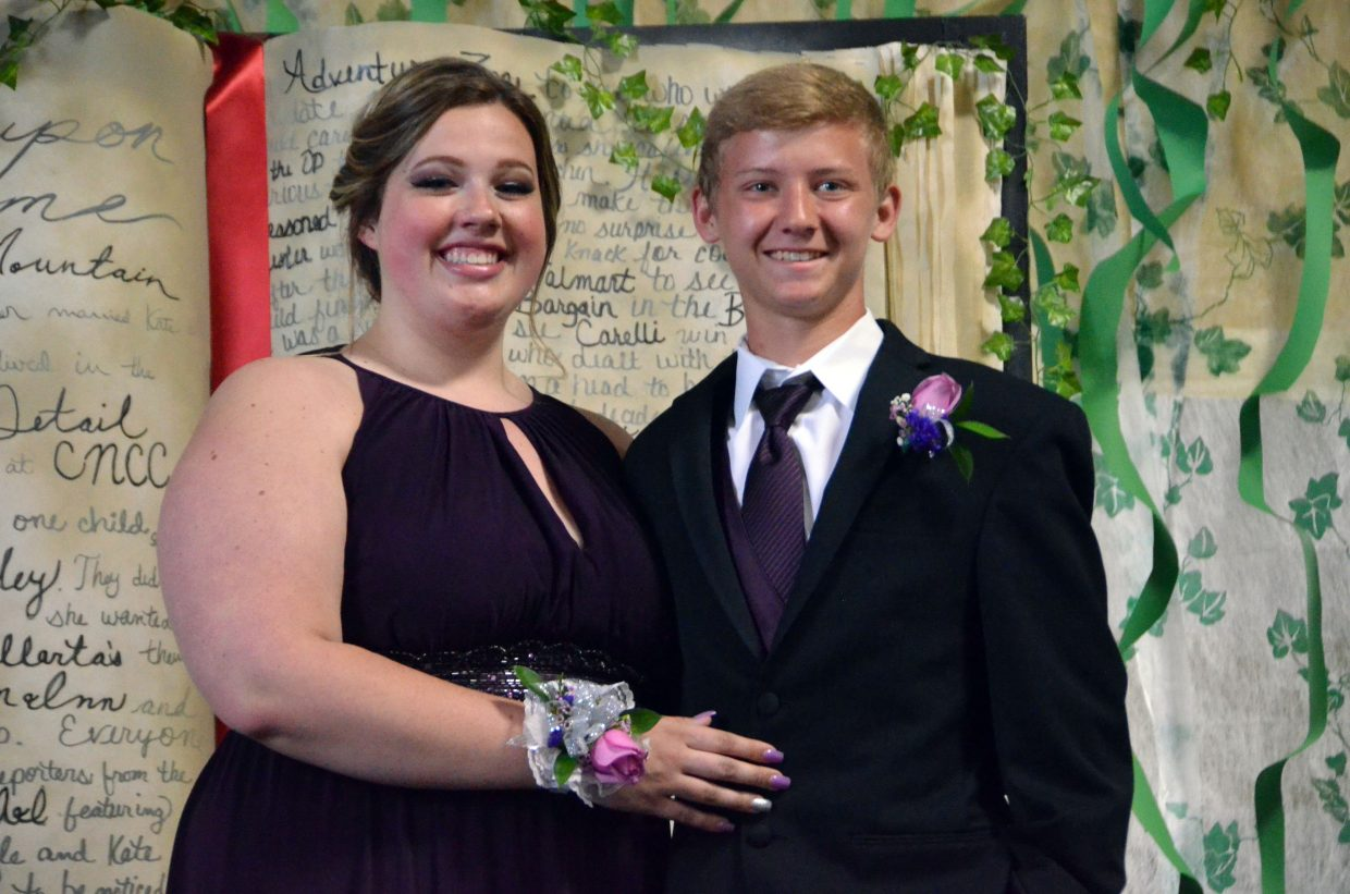 Jaycee Holman, left, and Cody Lewis pose for the Grand March during Moffat County High School prom at Clarion Inn & Suites.