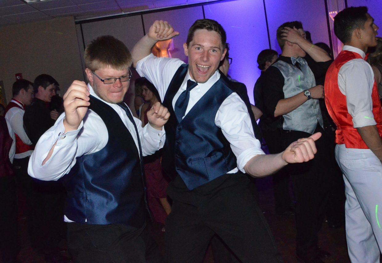 Zane Shipman, left, and Miki Klimper cut loose on the dance floor during Moffat County High School prom at Clarion Inn & Suites.