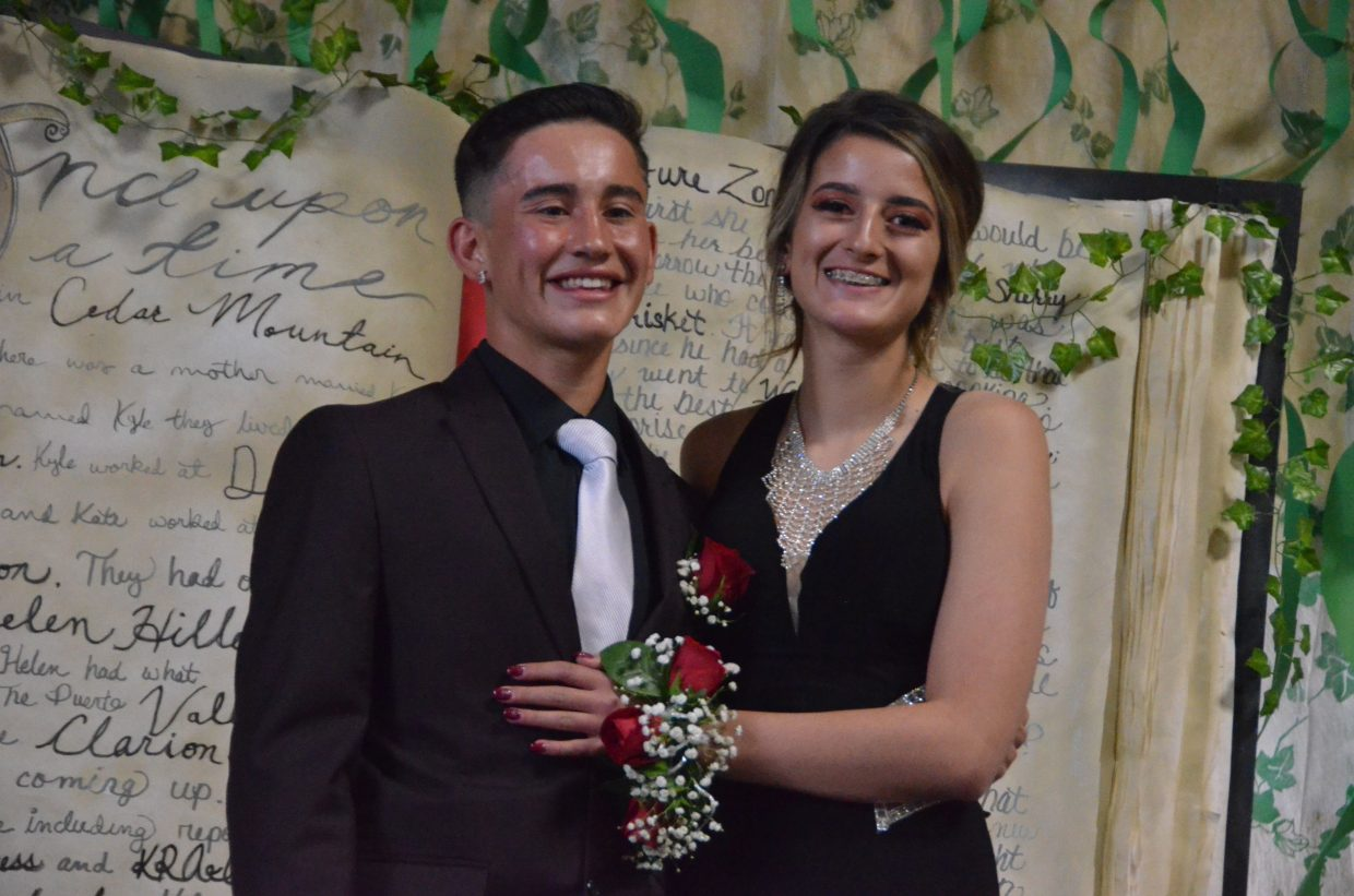 Juan Loya, left, and Hannah Vasquez pose for the Grand March during Moffat County High School prom at Clarion Inn & Suites.