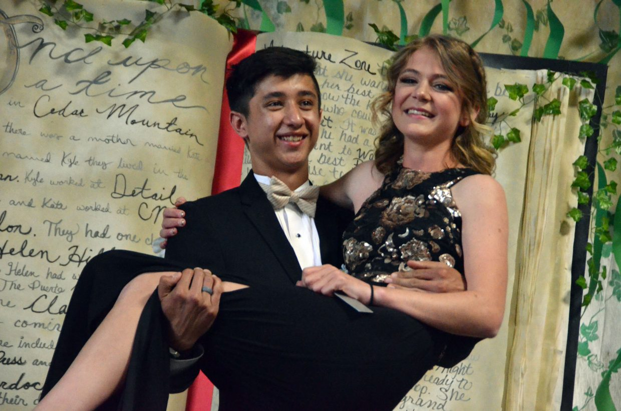 Sambu Shrestha sweeps Liberty Hippely off her feet for the Grand March during Moffat County High School prom at Clarion Inn & Suites.