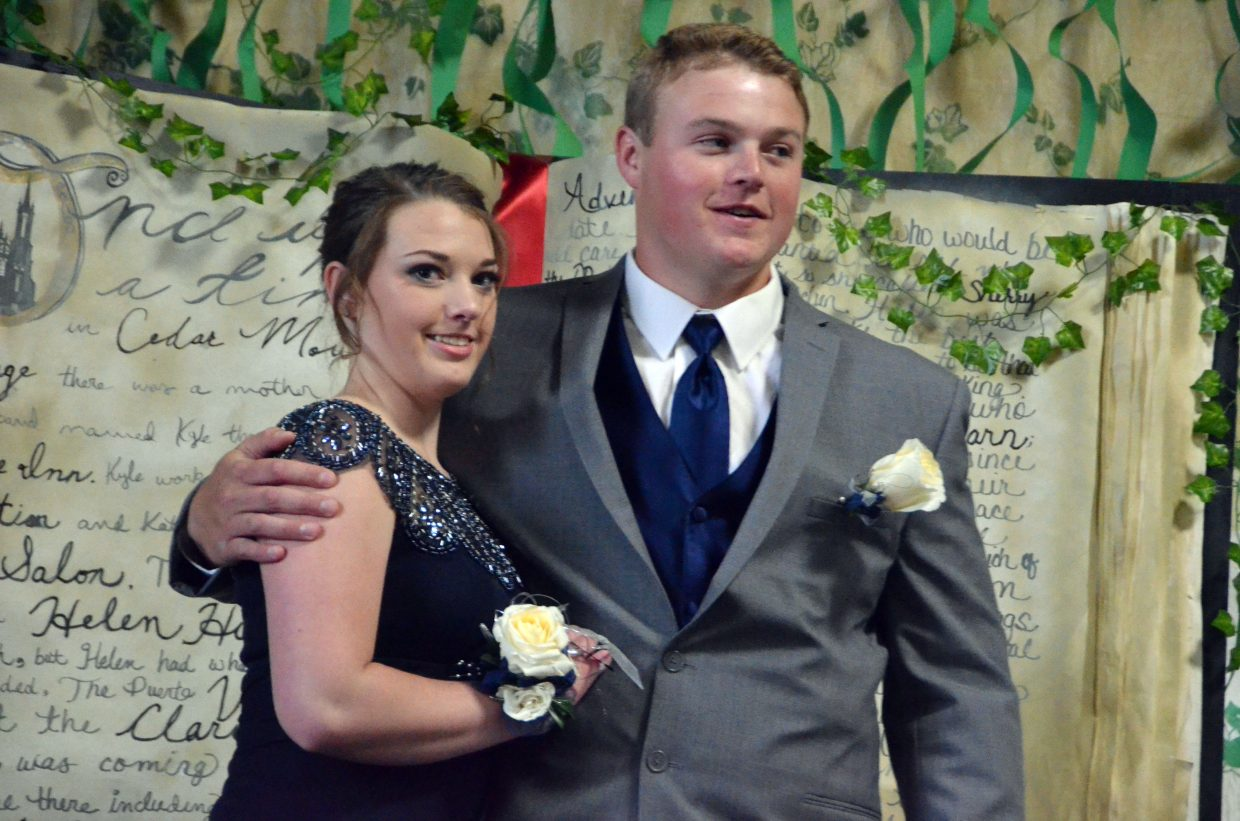 MaKala Herndon, left, and Jesse Earle pose for the Grand March during Moffat County High School prom at Clarion Inn & Suites.