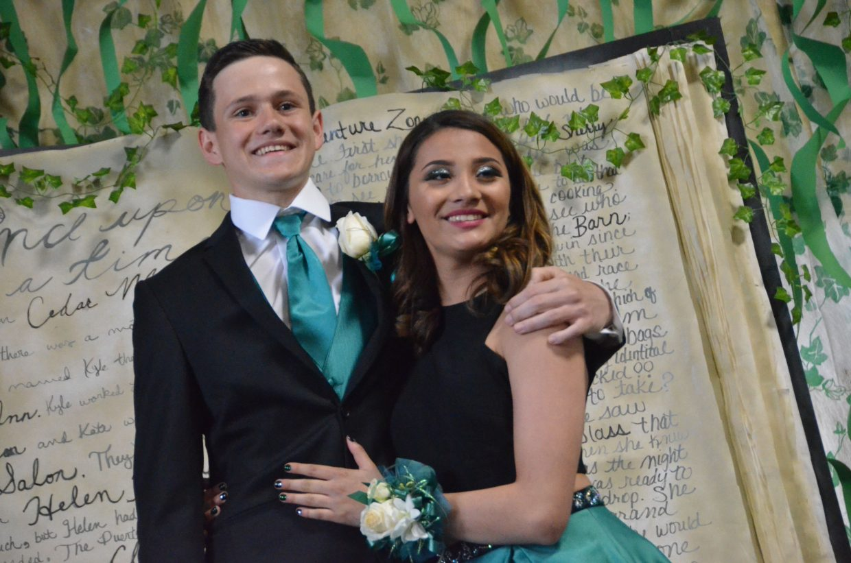Joe Campagna, left, and Alyssa Chavez pose for the Grand March during Moffat County High School prom at Clarion Inn & Suites.