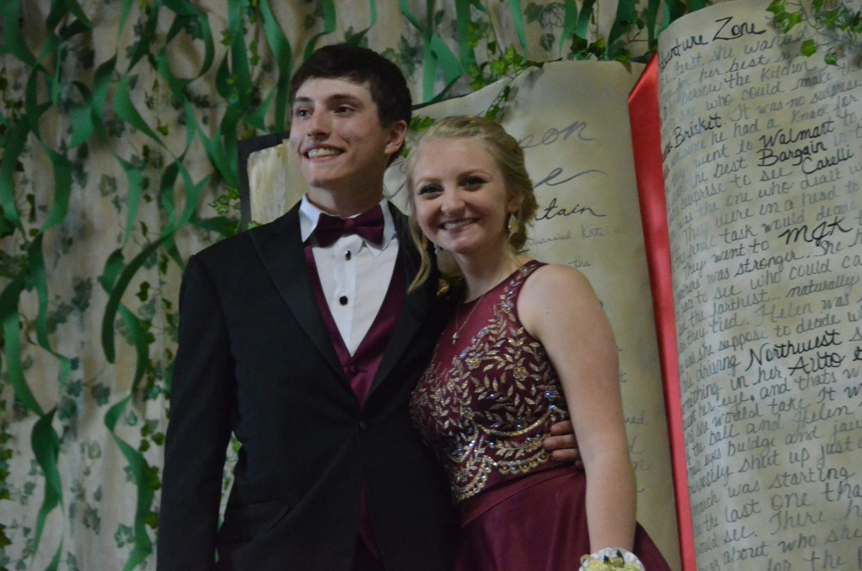Connor Murphy, left, and Caitlin Running pose for the Grand March during Moffat County High School prom at Clarion Inn & Suites.