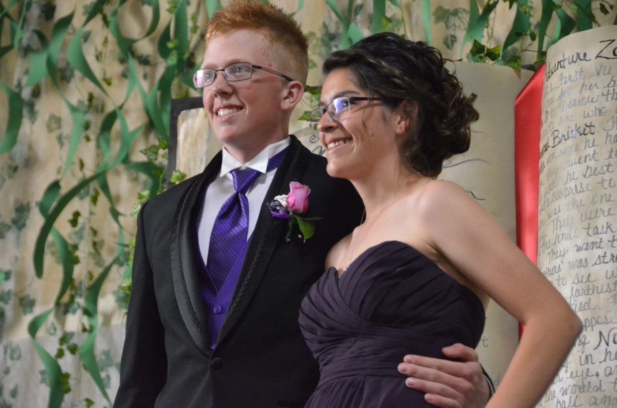 Trenton Hillewaert, left, and Alexis Main pose for the Grand March during Moffat County High School prom at Clarion Inn & Suites.