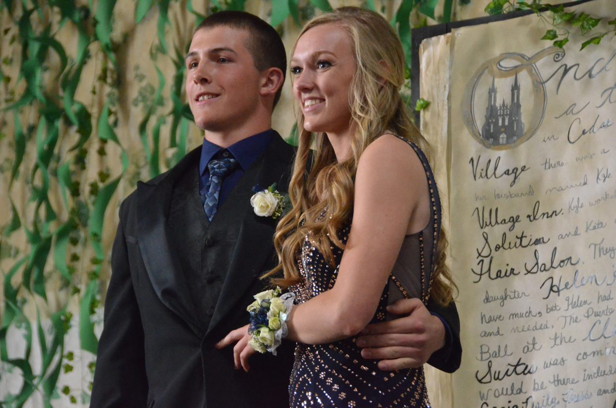 Elias Peroulis, left, and Addie Stanley pose for the Grand March during Moffat County High School prom at Clarion Inn & Suites.